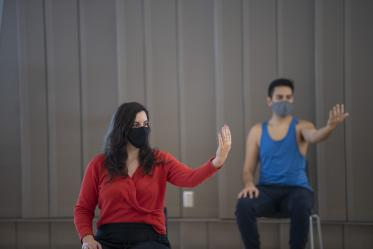 Jennie Greb, left, and Alex Murillo practice mindful movements during the Feldenkrais Method class inside the Forum in the Health Sciences Innovation Building.