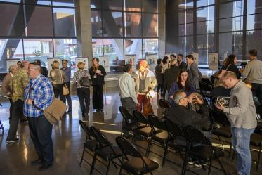 Attendees mingle inside the Health Sciences Innovation Building after the town hall event, Jan. 28, 2020.