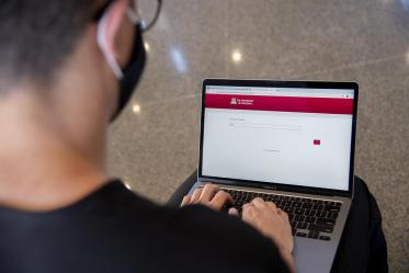 First year College of Medicine – Tucson student Charles Andrew Jauregui checks into Daily Wellness Screening on his laptop before heading to a class. The wellness checks must be completed using the Wildcat WellCheck screening tool, which allows employees and students to self-screen for symptoms.
