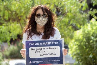 Michelle Ortiz, PhD., of the College of Medicine – Tucson's Office of Diversity, Equity and Inclusion, wears a mask for her community.