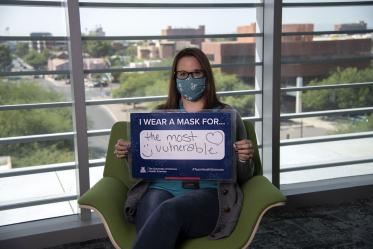 Laura Desteiguer, administrator with the UArizona Center for Innovation in Brain Science wears a mask for the most vulnerable.