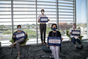 """Nicole Delatorre, Alex Thome, PhD, Shuhua Chen and Lucia Whitman, PhD, from the Center for Innovation in Brain Science share their inspiration in the UArizona Health Sciences """"I Wear a Mask"""" campaign."""