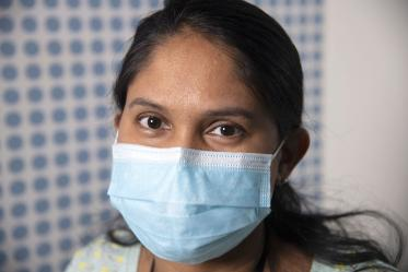 """Photographed proudly wearing a mask, Dhanalakshmi Shankara Raman, postdoctoral research associate with the UArizona Center for Innovation in Brain Science poses for the UArizona Health Sciences """"I Wear a Mask"""" campaign."""