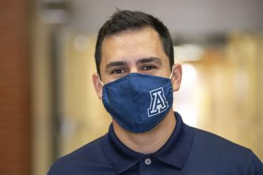 First-year College of Medicine – Tucson student Andres F. Diaz wears a mask for the immunocompromised, especially kids.
