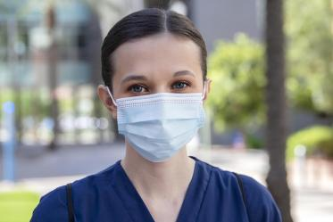 College of Nursing student BrookeLyn Black wears a mask for her patients in Tucson.
