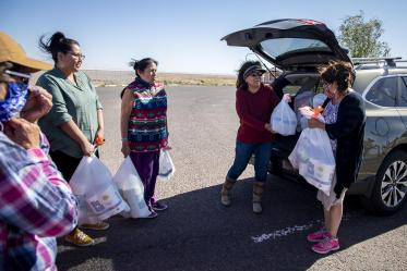 Cora Phillips hands out supplies collected from the University of Arizona Cancer Center drive to people who live in rural areas on the Navajo Nation. Phillips is a member of the Navajo Nation and serves on the Cancer Center's Community Advisory Committee for the Partnership for Native American Cancer Prevention (NACP), an NCI-funded project at the Cancer Center. The committee consists of leaders who are working in American Indian communities.