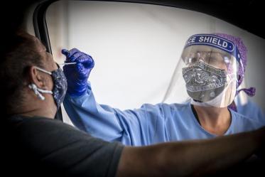 Tuba City Regional Health Care's Vivian Henderson conducts a COVID-19 test.