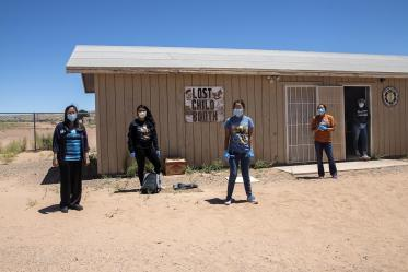 Vanessa Jensen, MD, stands with volunteers who help distribute supplies at a community center in Tuba City.