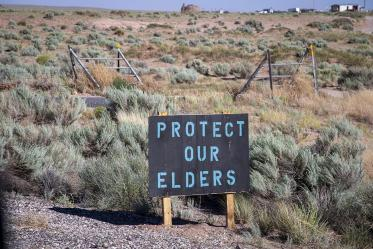"""A sign on the Navajo Nation in Loupe, Ariz. reads """"Protect our elders."""""""