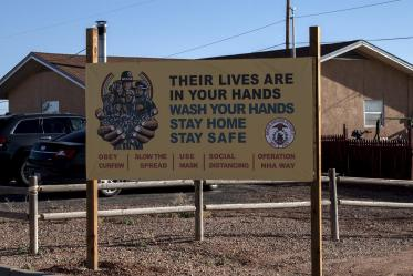 Signs and billboards are posted throughout the Navajo Nation asking tribal members to protect their family from COVID-19 by washing their hands and staying home.