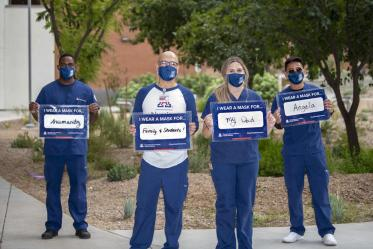 Decked out in UA Blue, from left: Aden Abdi, Philip Moya, MSN, BSN, RN, Kayla Killigrew and Nicolo Abrugena from the College of Nursing pose for the campaign. Moya is a clinical nursing instructor. Abdi, Killgrew and Abrugena are fourth-year nursing students.
