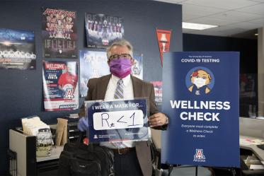 Terry Urbine, PhD, assistant professor at the University of Arizona Mel and Enid Zuckerman College of Public Health's Phoenix campus, shares his sign, showing that wearing masks can bring the R number of the virus that causes COVID-19 below 1. This number measures the average number of people someone shedding the virus will infect.