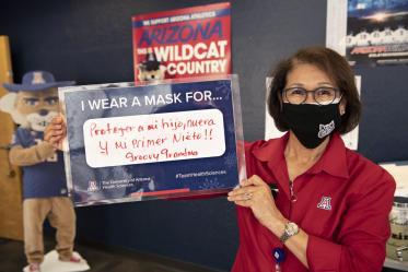 Cecilia Rosales, MD, MS, associate dean, Phoenix Campus, shares that she wears a mask to protect her first newborn grandchild during the COVID-19 pandemic in 2020.