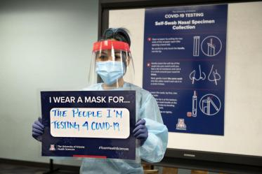 """Taking a break from her work testing the UArizona community on the Phoenix campus, Shannon Espinosa, RN, UArizona alumni, says she wears a mask """"for the people I'm testing for COVID-19."""""""