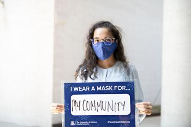 First-year College of Medicine – Phoenix student Prathima Harve holds a sign that says she wears a mask for her community. Harve is one of 32 students from the Colleges of Medicine in Tucson and Phoenix to be awarded a Primary Care Physician Scholarship this fall.