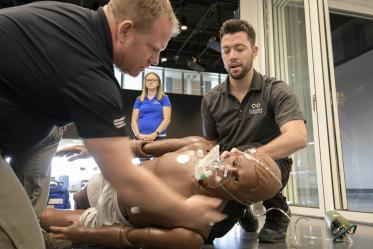 Using lifelike manikins, ASTEC personnel train staff from a local drug rehab facility to treat overdose with naloxone.