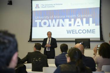 Senior Vice President for Health Sciences Michael D. Dake, MD, welcomes the audience to a town hall event in Phoenix.