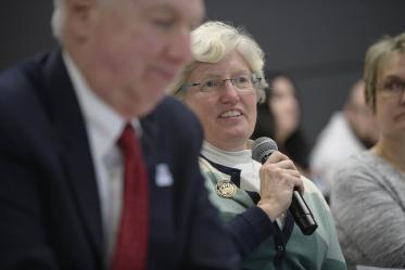 Lynda Ransdell, PhD, dean of Northern Arizona University's College of Health and Human Services, asks a question during the town hall.