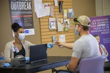 Alexandra Chaput checks Jacob Smith in for his appointment to receive the COVID-19 antibody test in early May at the Pima County Health Department on First Avenue in Tucson.