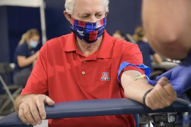 On April 30, the University of Arizona and the state of Arizona began an effort to test all frontline health care workers and first responders for antibodies to the virus that causes COVID-19. The first group included 4,500 first responders, health care workers, and some members of the general public from Pima County. UArizona President Robert C. Robbins undergoes a blood draw for his antibody test.