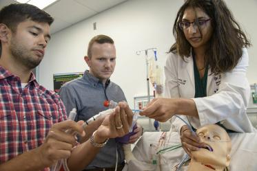 Pulmonary residents use ASTEC's SimDeck to practice medical procedures in simulated environments.