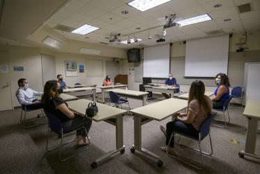 Conference rooms fit fewer people to allow for adequate physical distancing. Here, incoming first-year College of Medicine – Tucson students meet with their house dean, George Fantry, MD.
