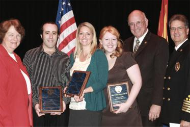 Professor Kelly Reynolds, PhD, MSPH, and two graduate students are presented with the Tucson Fire Department's Award of Service at a ceremony in the Tucson Convention Center on Feb. 19, 2010. Pictured from left: Tucson City Councilwoman Shirley Scott; Jonathan Sexton, PhD; Dr. Reynolds; student Kelly Hager; Tucson Mayor Bob Walkup; Tucson Fire Chief Patrick Kelly.