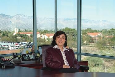 Iman Hakim, MD, PhD, MPH, is named dean of the college in 2008.
