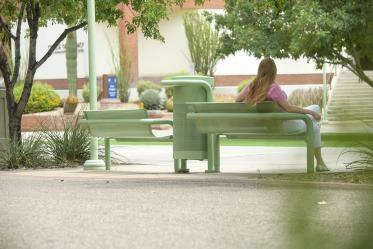 Sometimes a favorite place can be right in the middle of the action, like these shaded benches on the Tucson campus, flanked by a walking path on one side and a bike path on the other between Drachman Hall and the Medical Research Building.