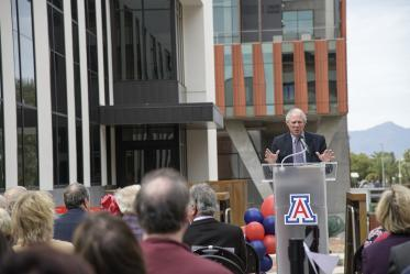 University of Arizona President Robert C. Robbins, MD, congratulates the College of Pharmacy on the Skaggs expansion and renovation project.