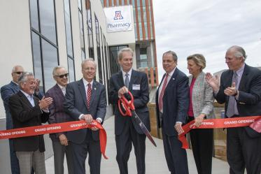 Ribbon cutting for the renovated and expanded Skaggs Center, from left to right: University of Arizona Foundation President and CEO JP Roczniak; donor Richard Katz; donor Ken Coit; UArizona College of Pharmacy Dean Rick Schnellmann, PhD; Ronny Cutshall, president of The ALSAM Foundation, which was established by the Skaggs family; UArizona Senior Vice President for Health Sciences Michael D. Dake, MD; UArizona Provost Liesl Folks, PhD; UArizona President Robert C. Robbins, MD.