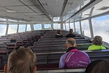 The riders took a ferry from Michigan mainland to Mackinac Island, where no motorized vehicles are permitted. The group practiced social distancing on the ferry.