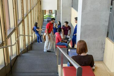 The eastern stairway between the fourth and sixth floors in the Health Sciences Innovation Building has a built-in seating areas with a view. Each padded seating area is also equipped with electrical outlets.