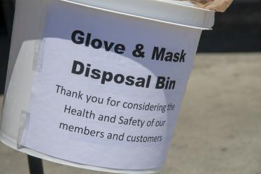 A glove and mask disposal bin in a Food City grocery store in Tucson, one of many changes grocery stores have implemented to help protect public safety in the pandemic. The store is also hanging posters designed by College of Medicine – Tucson students to help encourage masking, social distancing and hand washing.