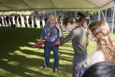 During the smudging ceremony, Dr. Carlos Gonzales blesses each individual student, faculty and staff member present.