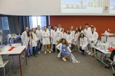 UArizona College of Medicine – Tucson first-year medical students pose for a group photo after being fitted for their white coats inside the Health Sciences Innovation Building prior to the white coat ceremony.