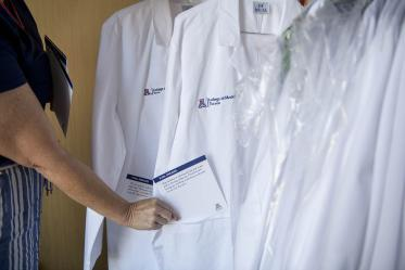 Each white coat presented has an inspirational note in the pocket written by faculty and staff.