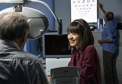 Anna Figueroa conducts a visual acuity test on a study patient.