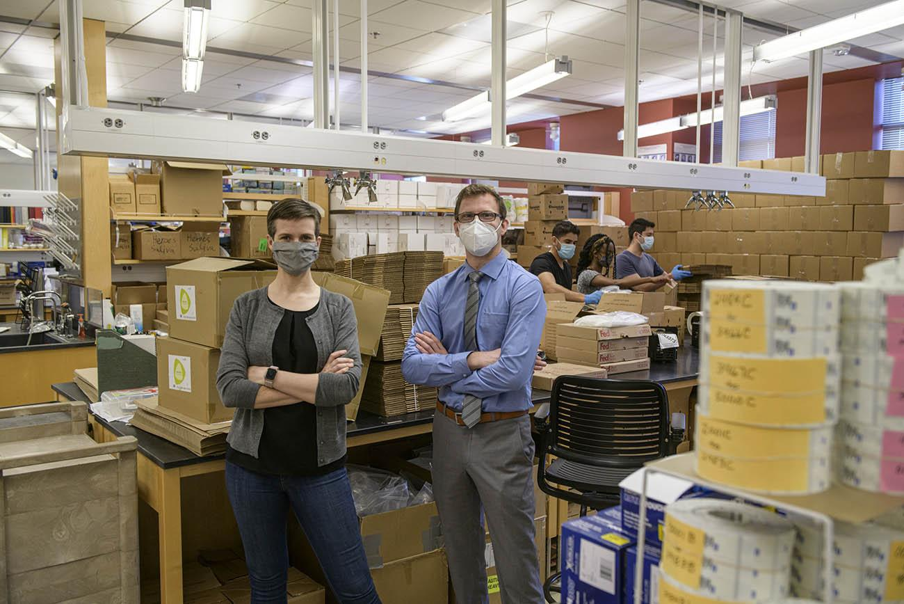 AZ HEROES researcher Karen Lutrick, PhD, with research specialist Shawn Beitel, who oversees the production of the kits that are mailed to AZ HEROES participants.