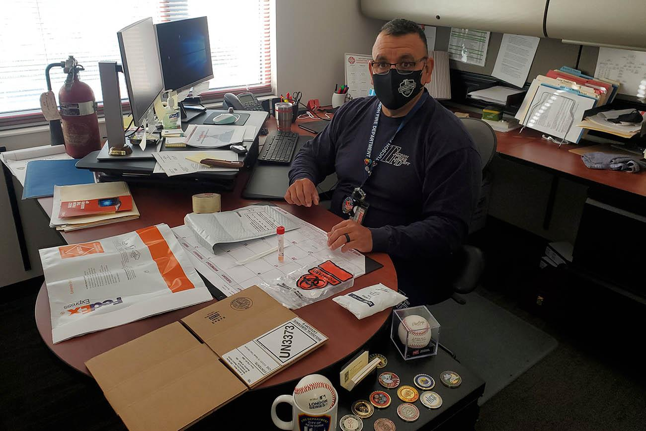 Tucson Fire Department Captain John Gulotta prepares for a nasal swab, which will be returned to researchers in the supplied packaging via Federal Express. (Photo: Tucson Fire Department Safety)